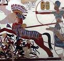 800px-Ramses_II_charging_Nubians_edited.