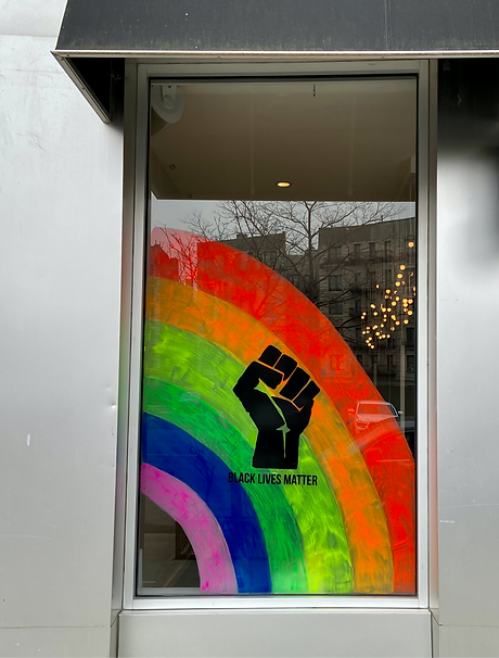 A%20storefront%20window%20in%20Harlem%2C%20New%20York%2C%20painted%20with%20a%20BLM%20Pride%20sign_e