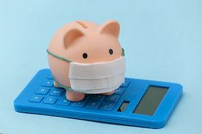 Piggy bank with medical mask and calcula