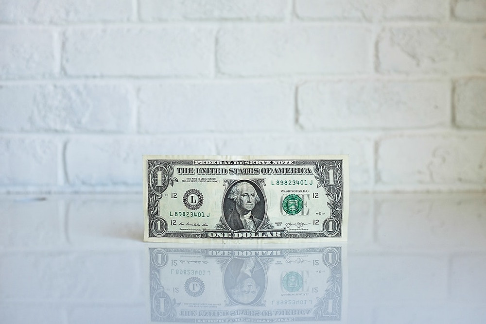 dollar bill against white wall where to spend lead generation budget
