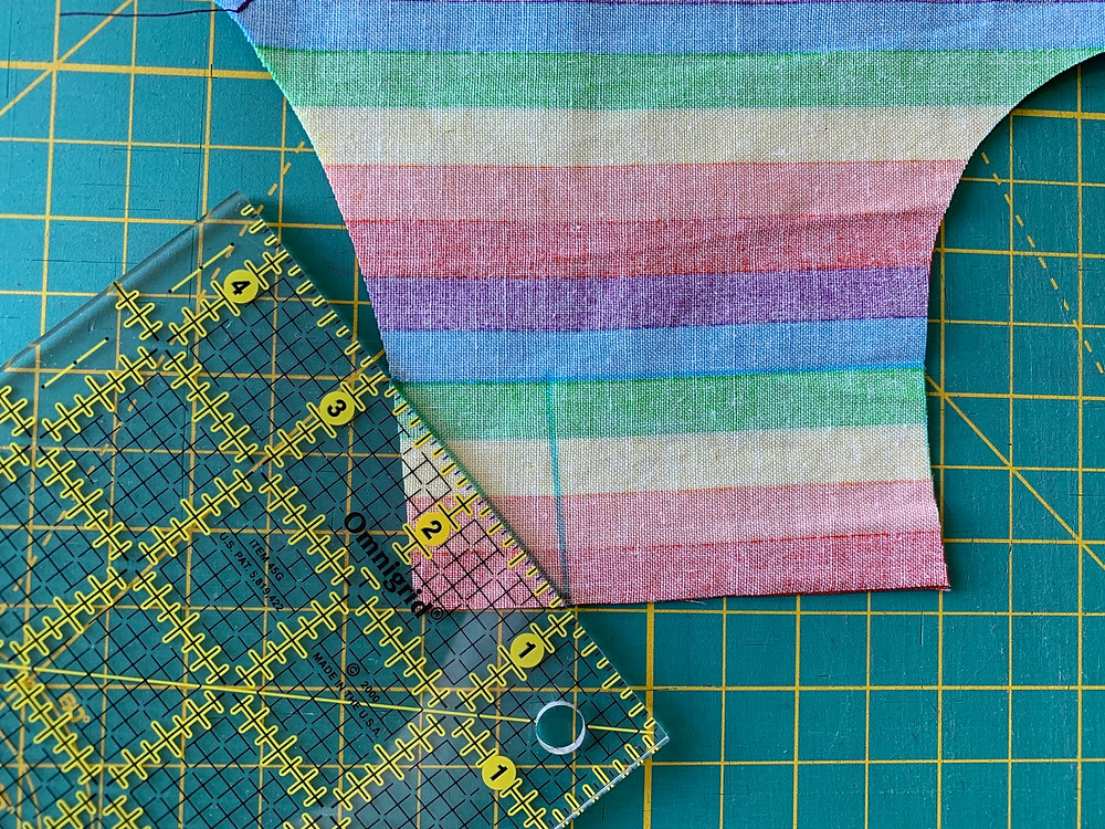 Using your washable fabric pen, draw a line connecting the right outside edge of the casing fold line to the bottom of the perpendicular line you have drawn. Repeat for the left edge of your Outside piece.