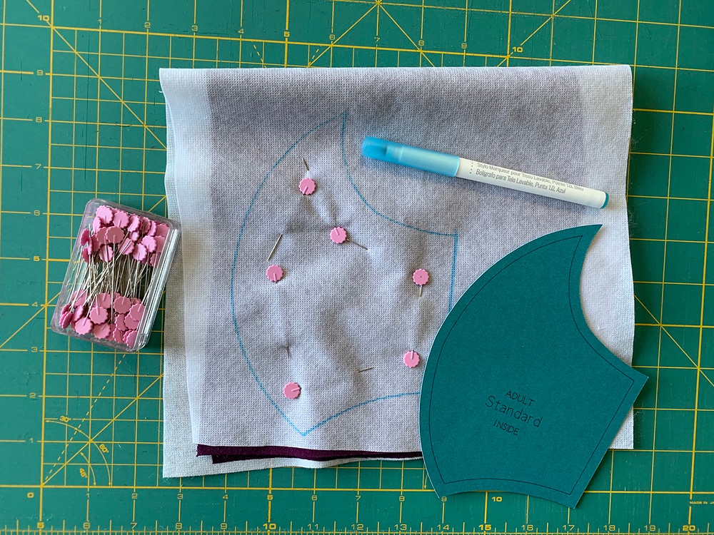 Pin through both sides of the fabric, so that they don't move while cutting.