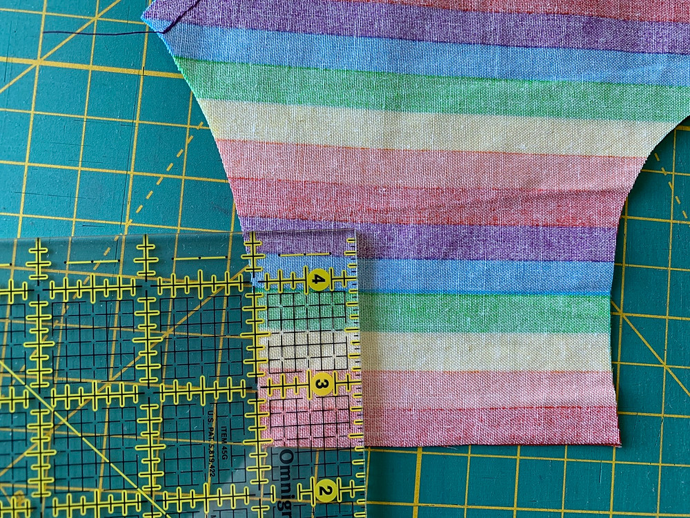 """With your washable fabric pen, measure 1"""" from the right edge of your Outside piece and draw a perpendicular line from the casing fold line to the edge of your Outside piece. Repeat for the left edge of your Outside piece."""