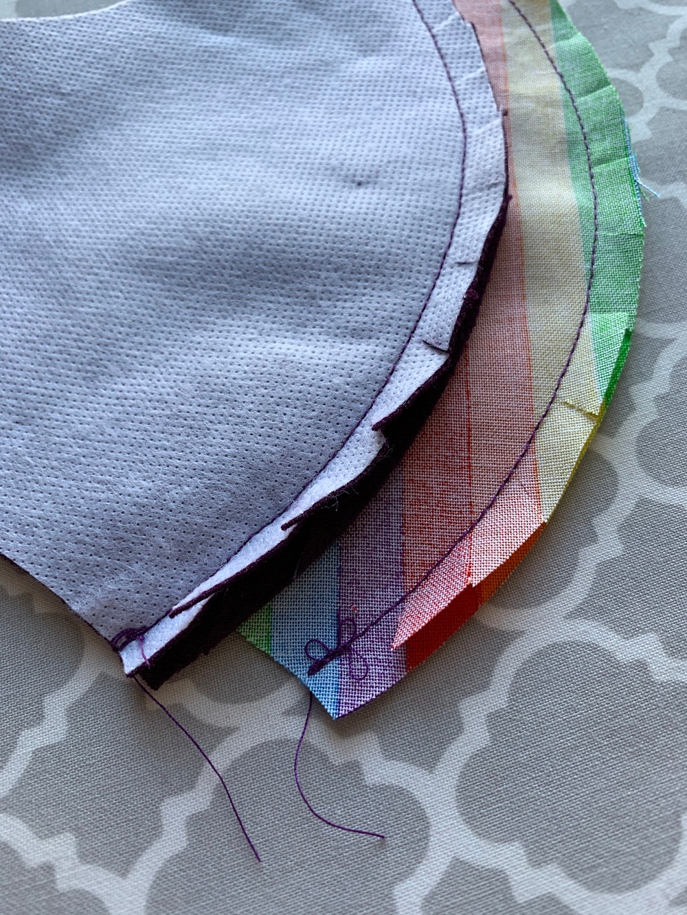 Snip along the curve of both pieces, being careful not to cut through the stitching.