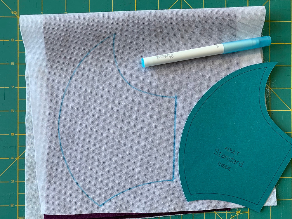 Using your washable fabric pen, trace around the outside edge of the pattern.