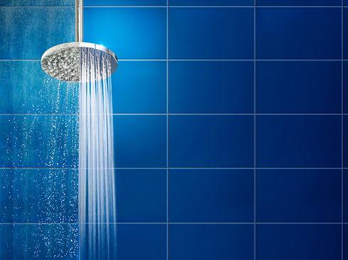 Running shower against blue tiles.jpg