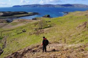 Walk over survey Isle of Ulva with a view of the coast.PNG