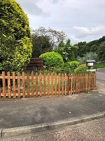 Picket fencing round a front garden.jpg