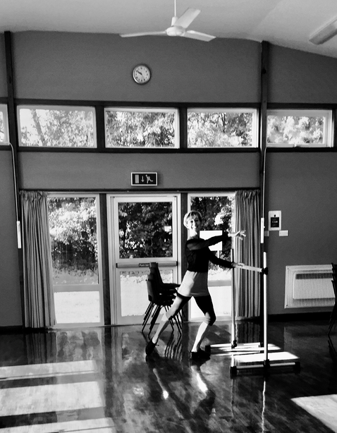 Deborah Nankivell practising in a studio.png