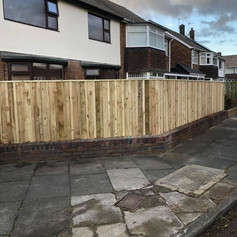 New fence built on top of a wall.jpg