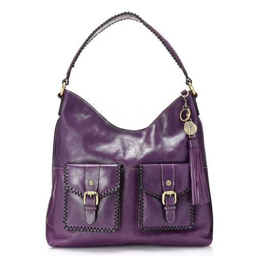 4b3a90eefbd4 Diversify your style with this boldly whipstitched, genuine leather bag -  it's sure to send heads whipping around! The grained exterior adds a touch  of ...