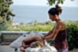 Woman massaging woman. Study massage abroad.