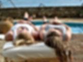 Laying side-by-side. Study massage abroad.