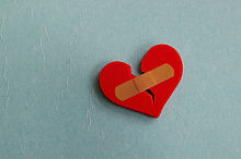 broken heart with a bandage, on blue.jpg