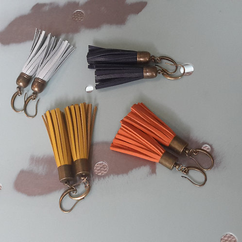 Orange leather tassel ear rings