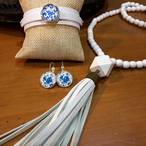 White wooden bead with genuine leather tassel