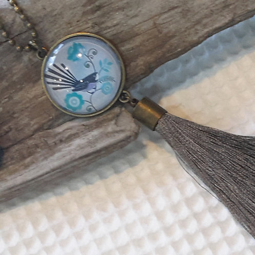 Fantail pendant with tassels