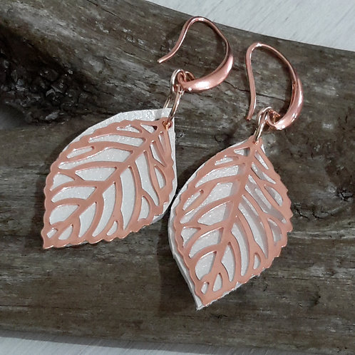 Rose gold and white leather ear rings