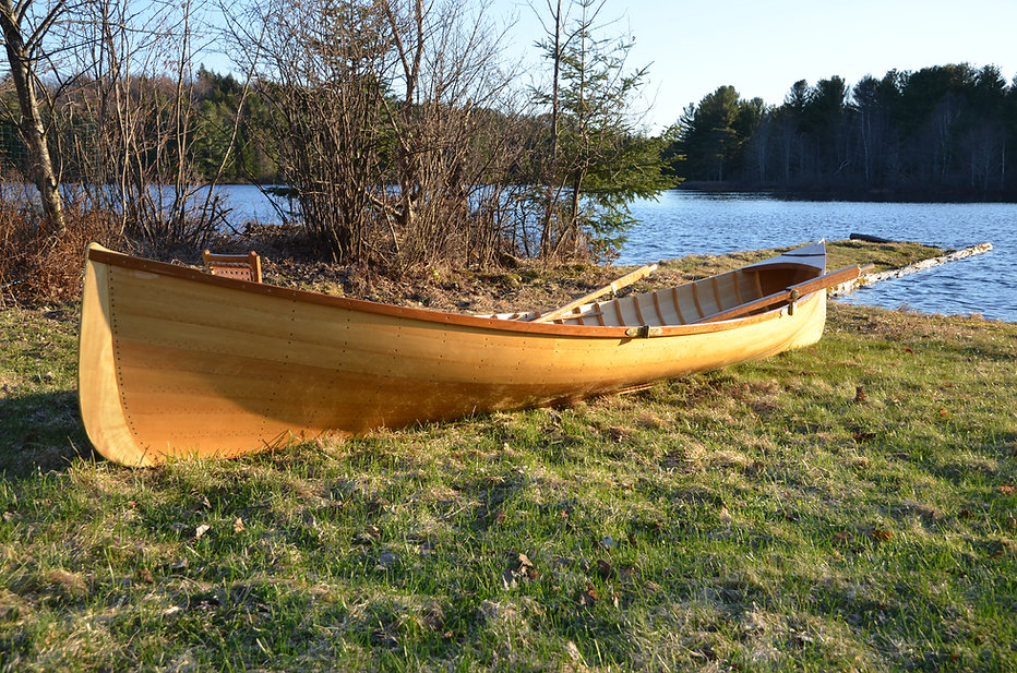 Traditional Wooden Adirondack Guideboat on a dock