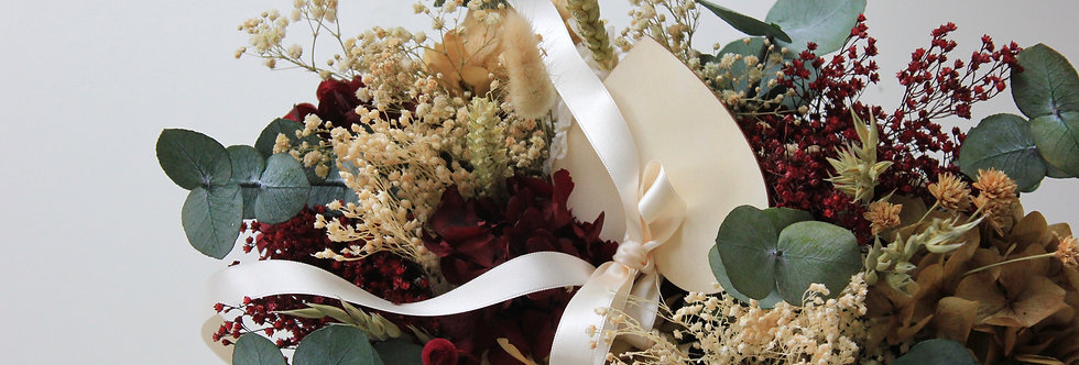 Capazo de flor preservada burdeos