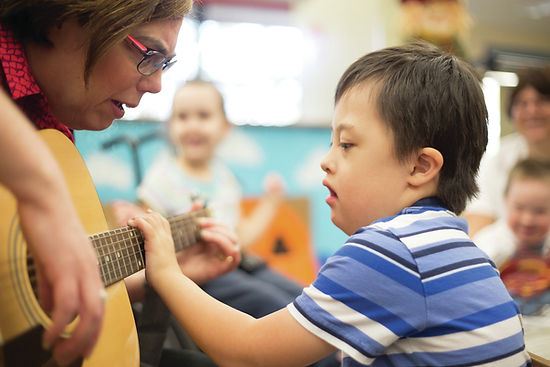 autistic child playing guitar
