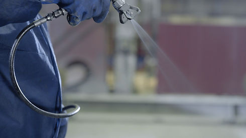 Arm hand holding industrial size spray g