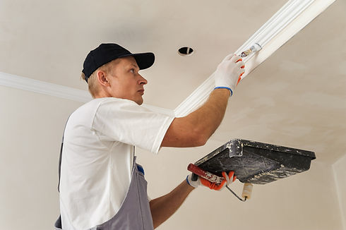 Painting walls and ceilings. Painter pai