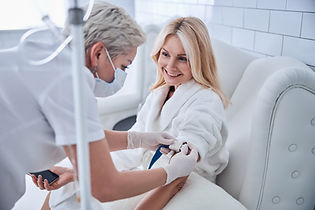 Side view portrait of happy cheerful talking with professional doctor while receiving IV i