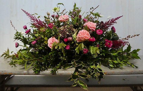 coffin top funeral flowers.jpeg