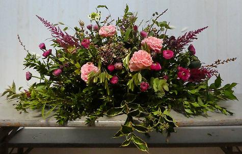 coffin top funeral flowers.jpeg
