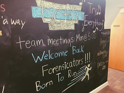 The Berry College Forensics headquarters welcomes students with a chalkboard that has speech and debate team information and encouragement.