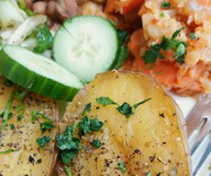 Baked potatoes, cauliflower stew, warm beans and salad