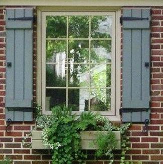www.shuttertimedealerships.com- board & batten shutters closed