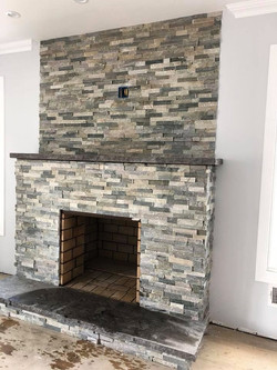 Gorgeously done fireplace with stone