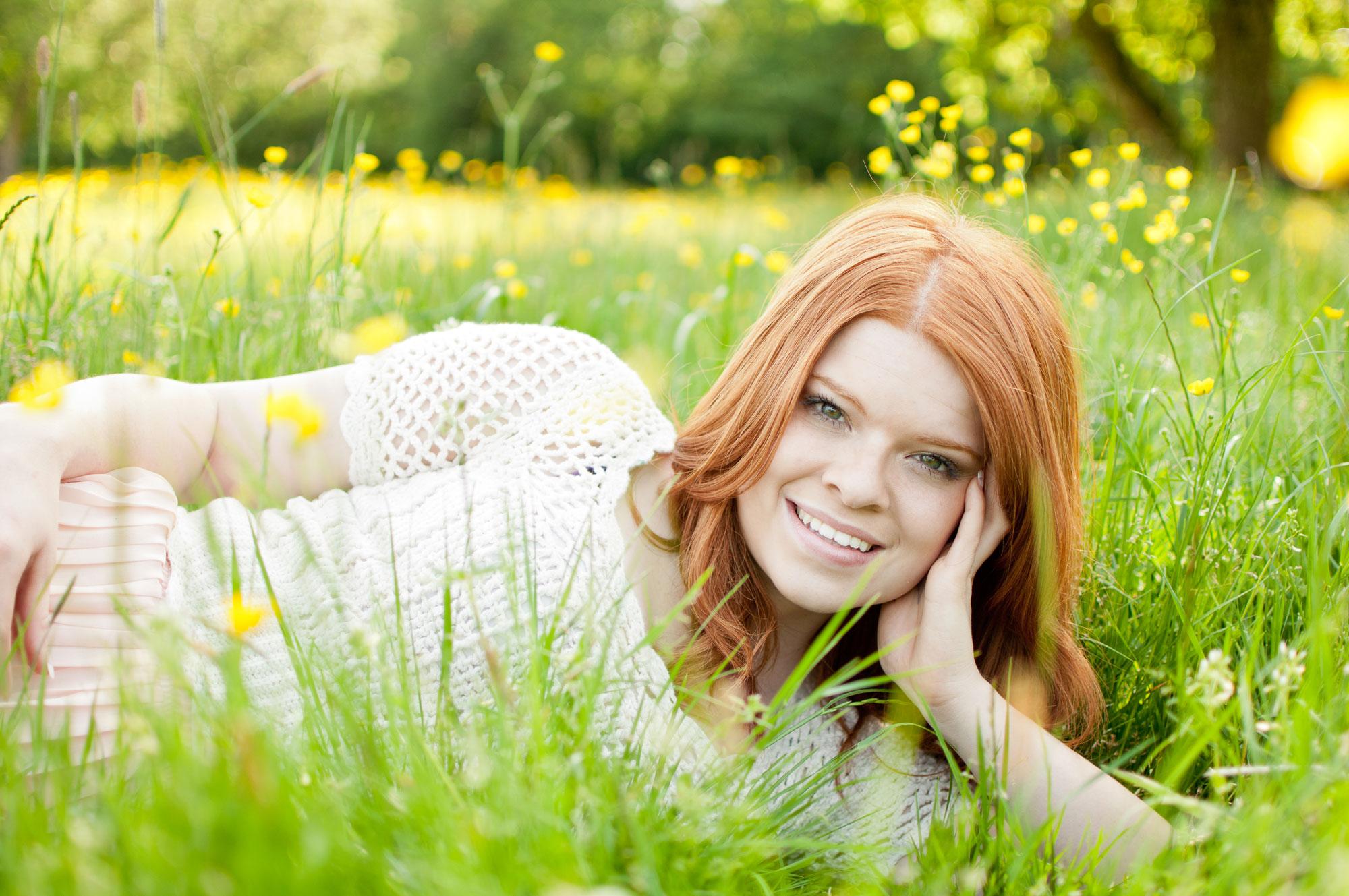 Senior girl in grass field