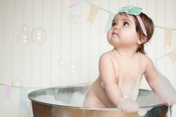 1 year old in the tub with bubbles