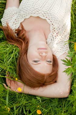 Senior girl in grass