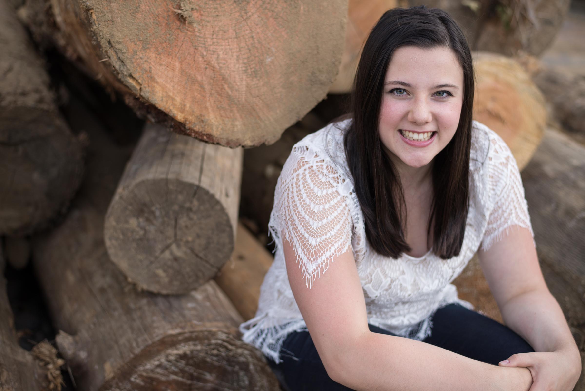 Senior girl on logs