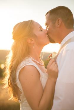 Wedding Kissing in the sun