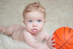 Newborn with a basketball
