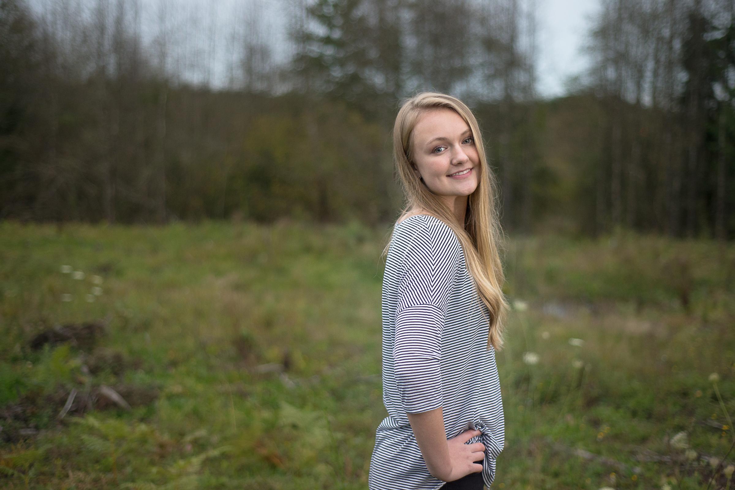 Senior girl in field