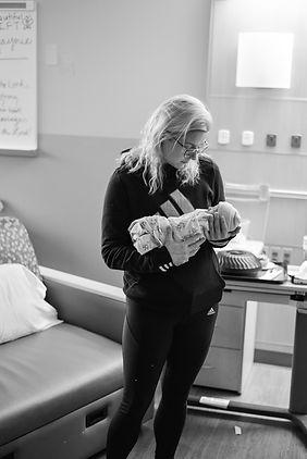 Loriana holding a newborn baby