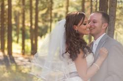 Wedding laughing kiss on the cheek