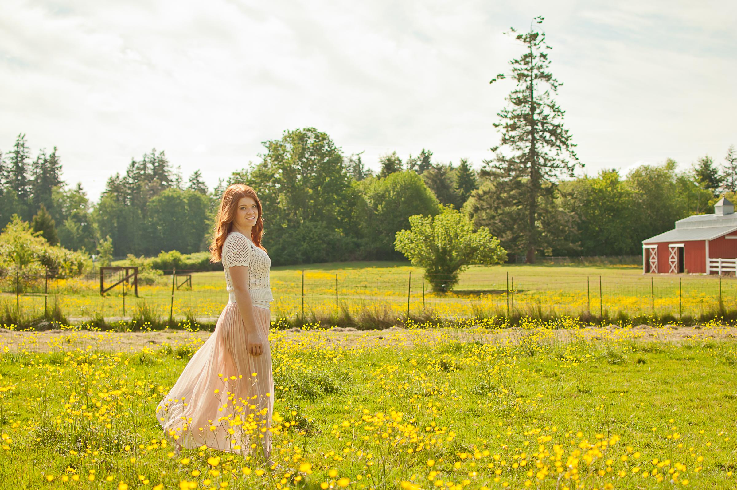 Senior girl in farm field