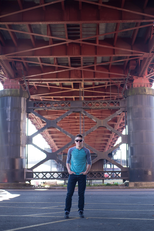 Senior boy on steel bridge