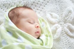 newborn in a blanket