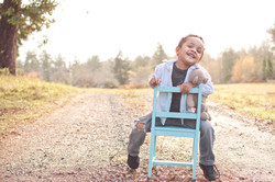Little boy in a chair on the road