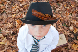 young boy in leafs