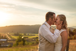 Wedding kissing in the sunset