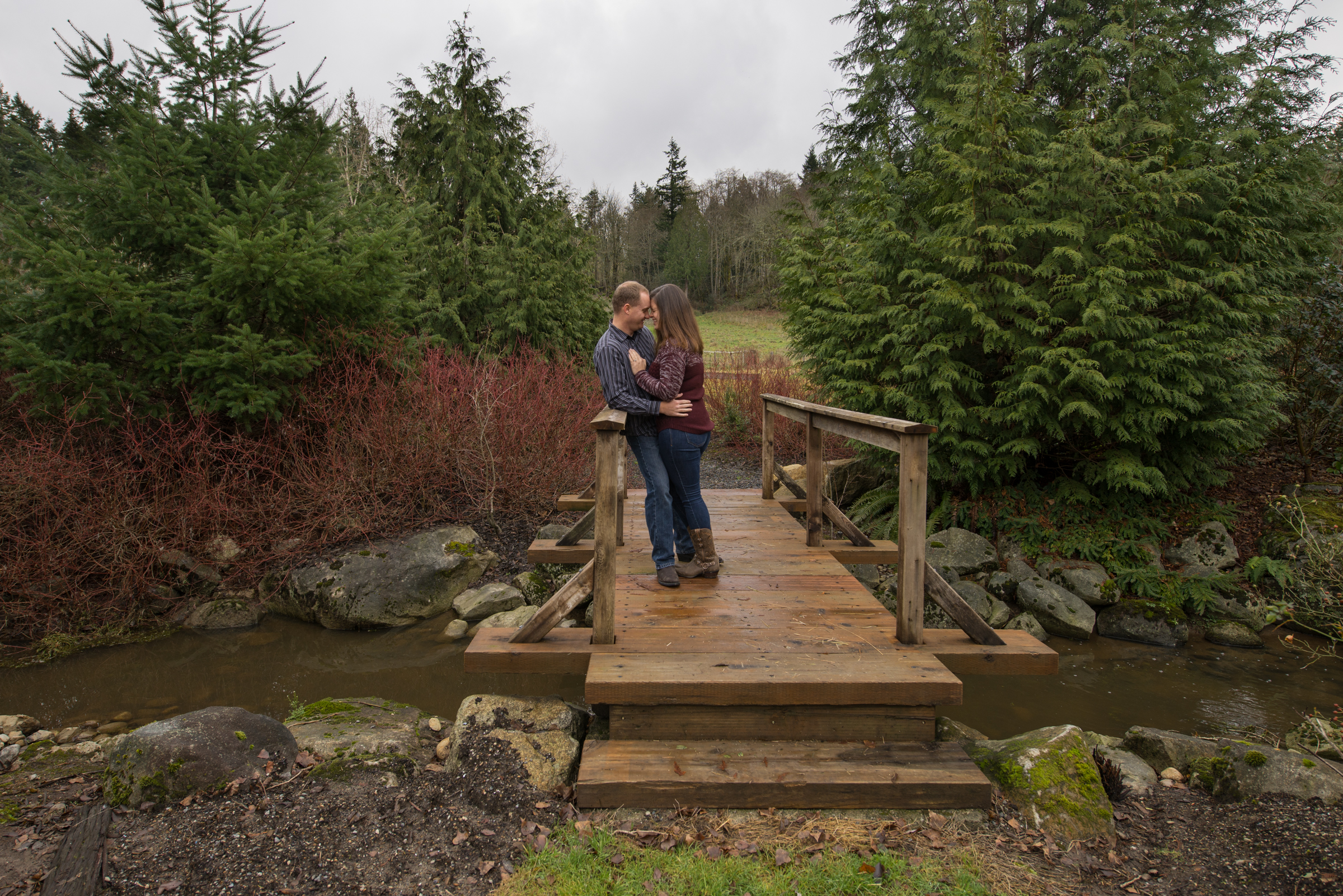 engagement couple on bridge